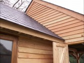 Green Douglas Fir garage with games room, workshop and log store