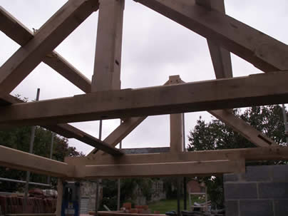 Traditional green oak truss and purlin roof