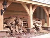 Log store with traditional bracing to the posts